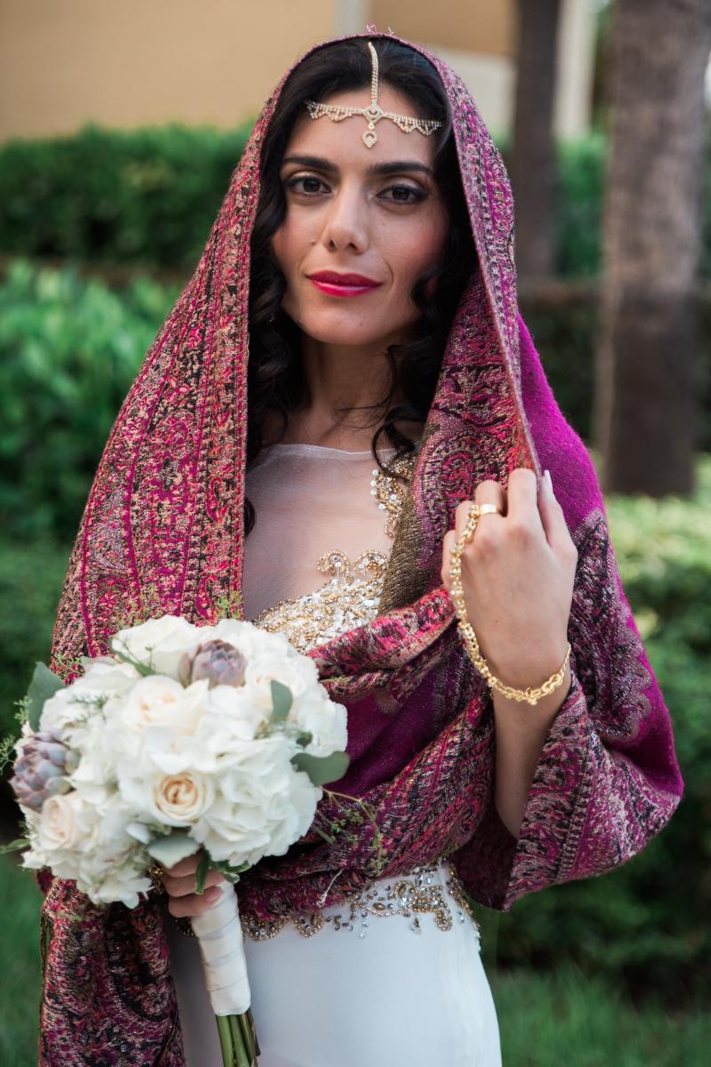Bride outdoor portrait close-up holding flower bouquet