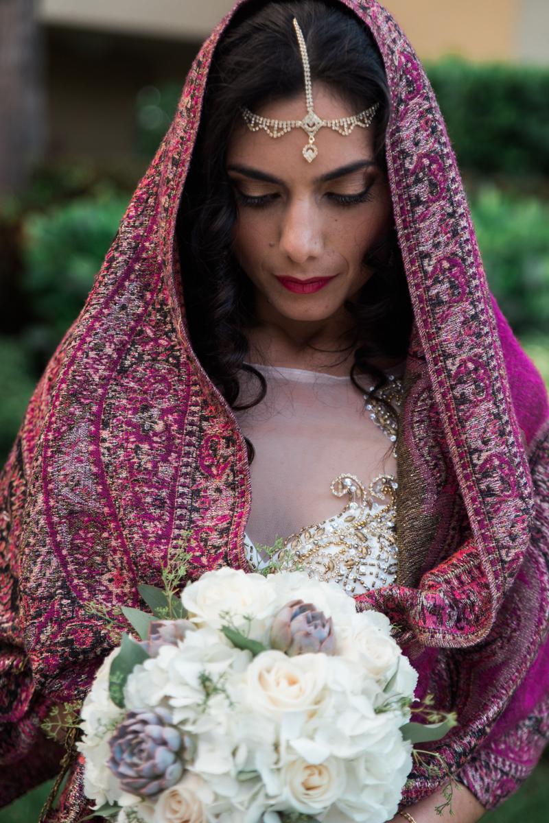 Bride outdoor portrait holding flower bouquet