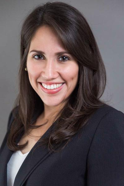 indoor headshot gray background woman suit