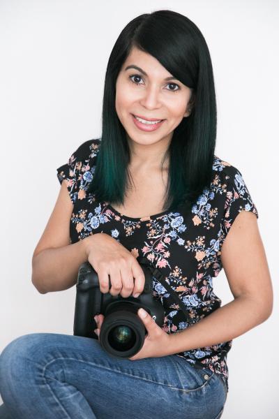 indoor headshot photographer holding camera white background