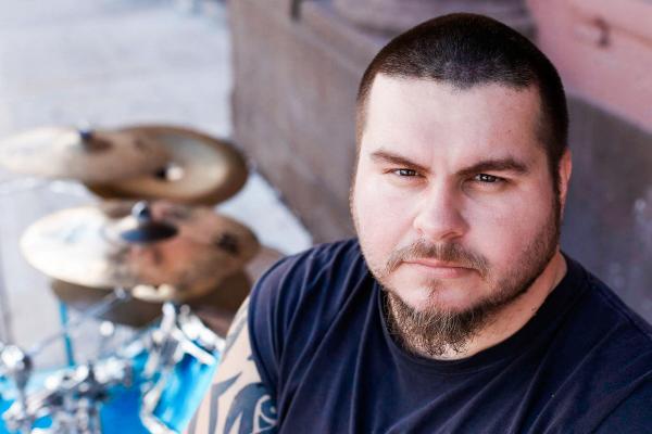 outdoor headshot drummer man cymbals