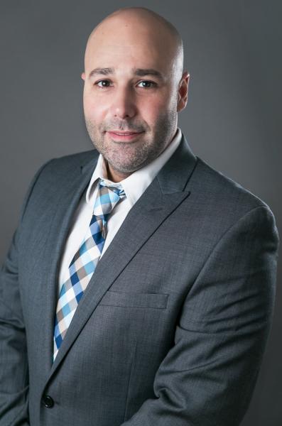 indoor headshot gray background man realtor suit