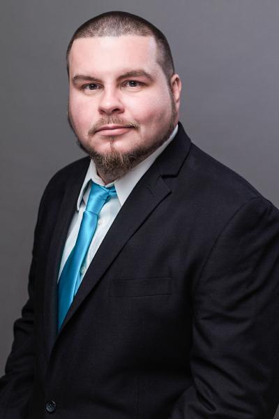 indoor professional headshot gray background man suit blue tie