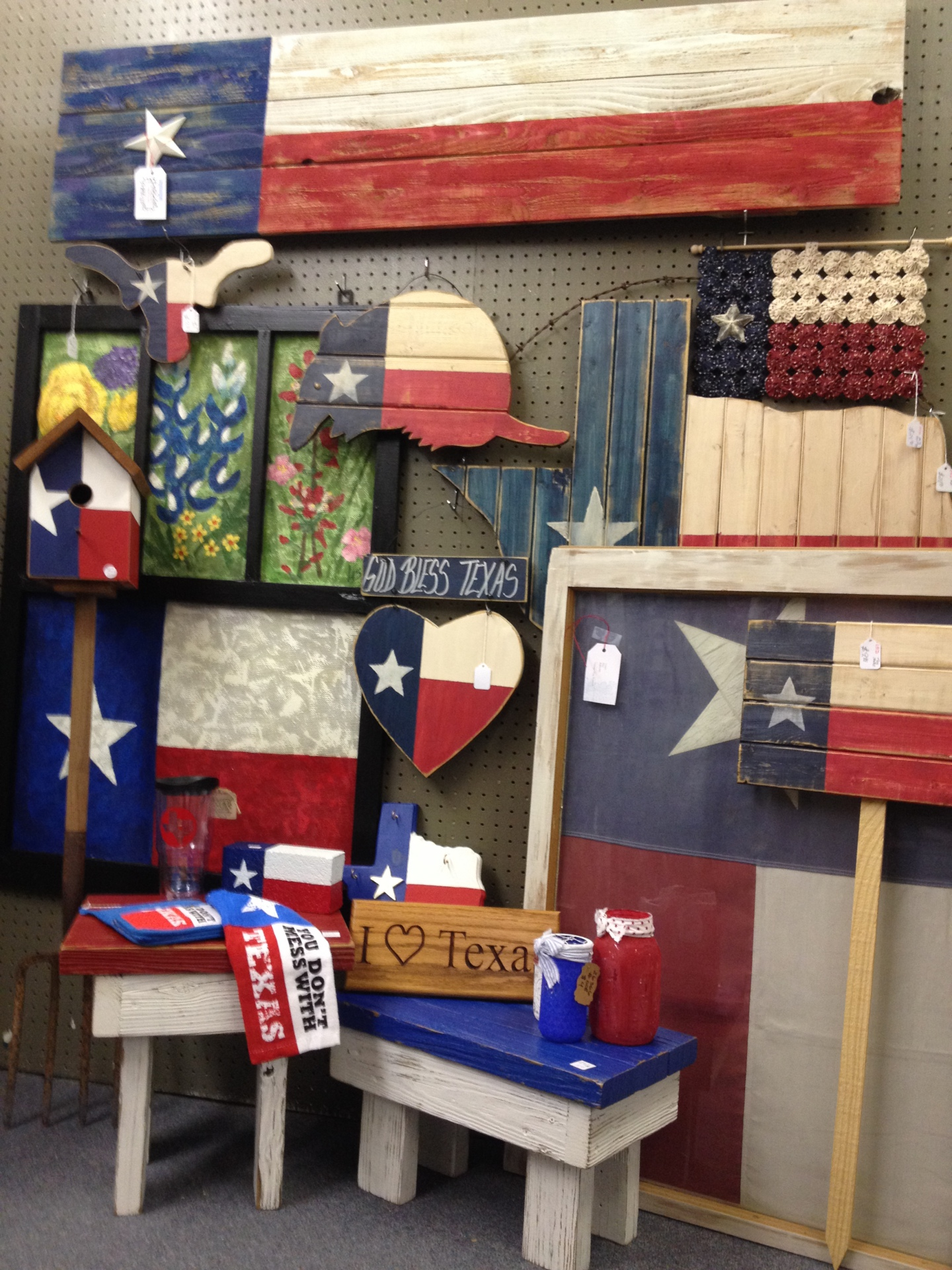 "Texas flags, Texas signs, old windows with flags, wood stools, armadillos, ""I love Texas"" signs"