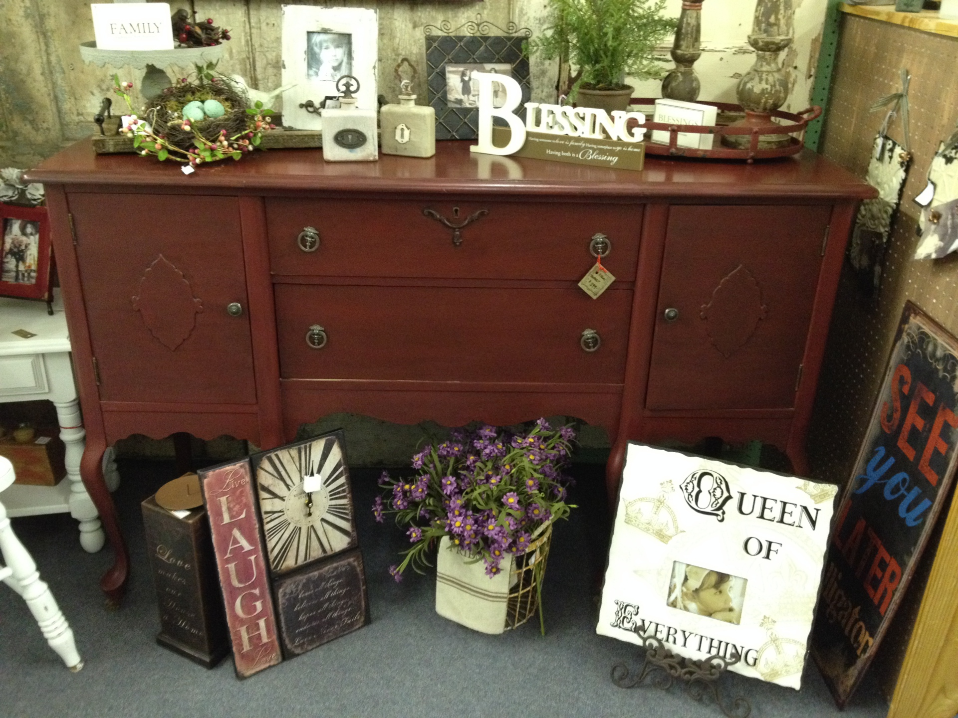 Restored antique buffet, Blessing sign, candle holders, wreaths, and picture frame.