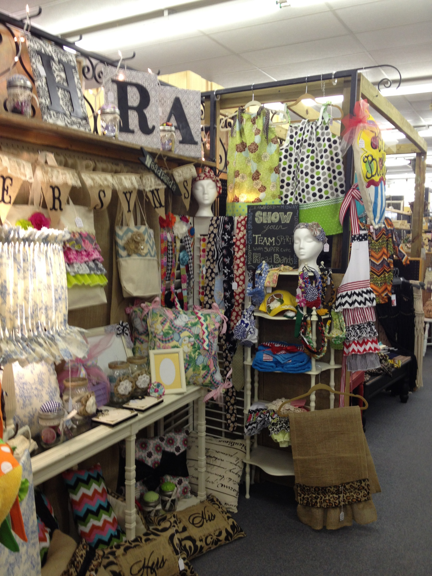 Lace, burlap wall hangings, restored lamp shades and other great finds.