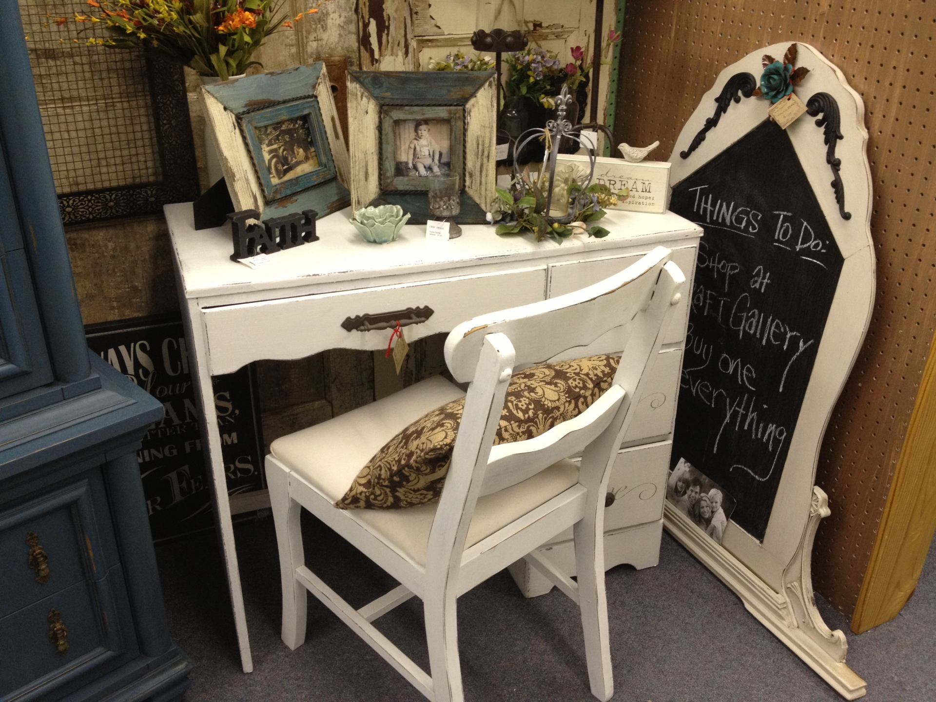 Vintage white desk and the chalk board to go with the picture frames are the start to your antique shopping Waco.