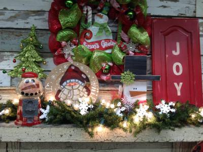 Christmas decorations which include Santa, snowmen, Christmas wreaths, mantle decorations.