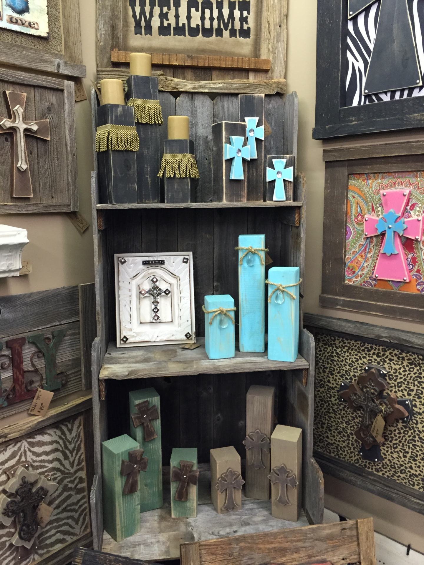 Rustic wood candle holders that are one of a kind. Crosses, stars to match the wall hangings