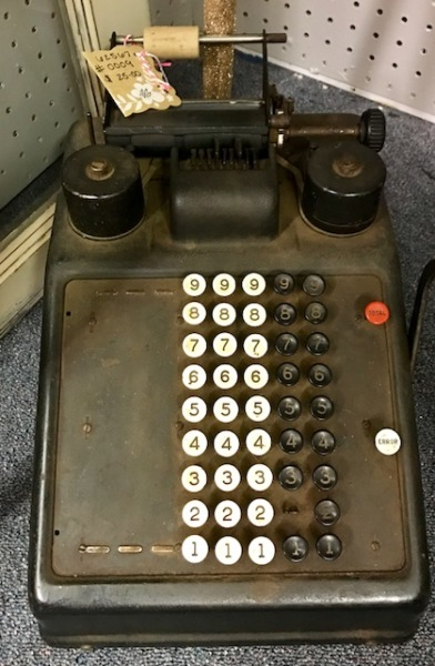 "This manual adding machine is for doing math ""old school"""