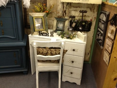 Distressed furniture like this white desk, candle holders, distressed wood frames
