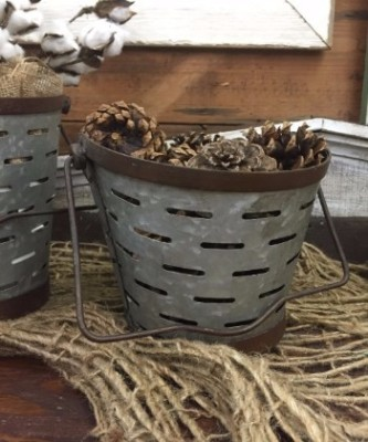 Galvanized olive buckets that are great for home accents. Galvanized is in right now.