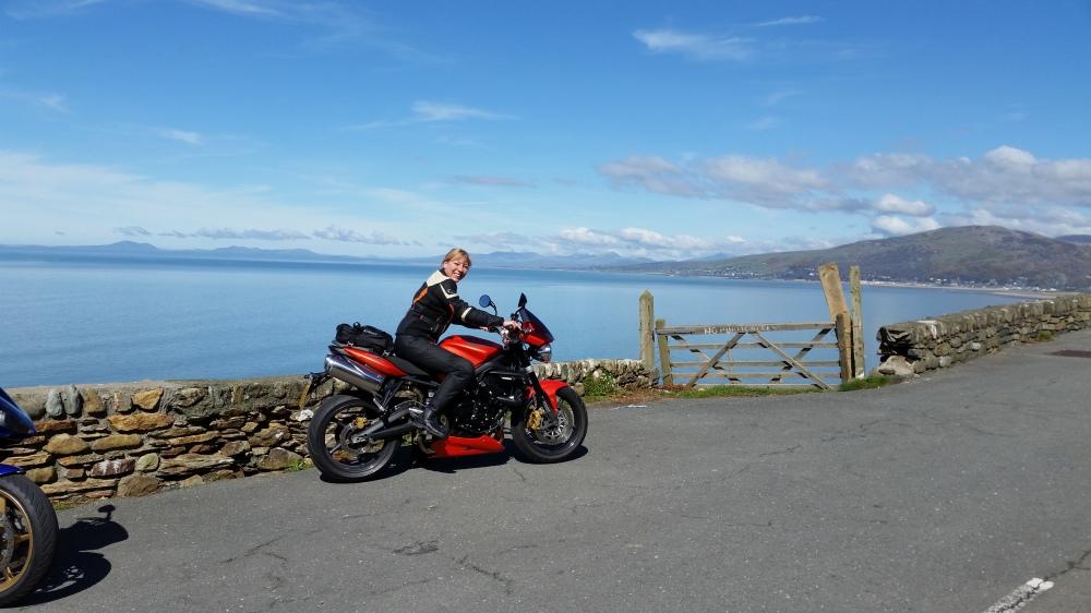 lady riding orange triumph motorbike
