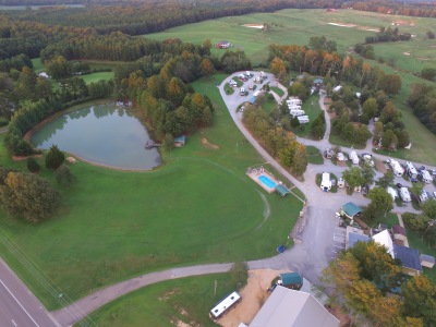 Aerial Shot of Park including edge of Repair Shop in Front