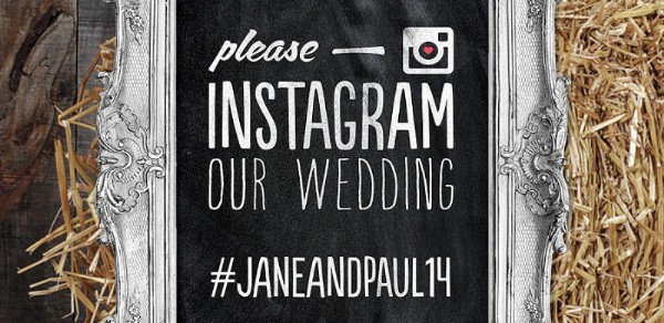 Photo of chalkboard with Instagram hashtag to be used by guests.
