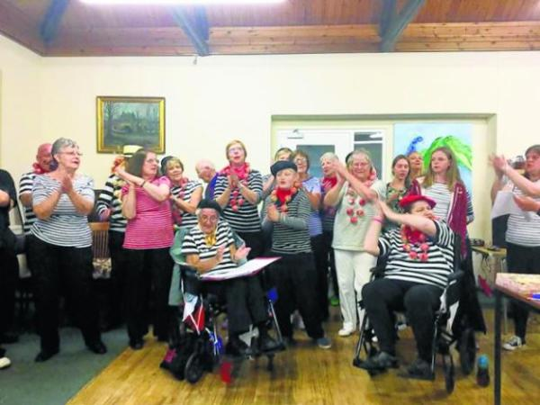 MP's pledge on French trip with community choir