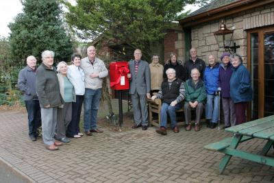 Munks' Muir residents and George with new post box