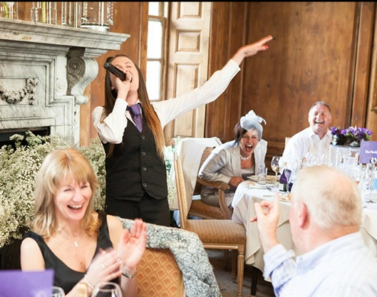 Singing waitress mid song surprising the wedding guests