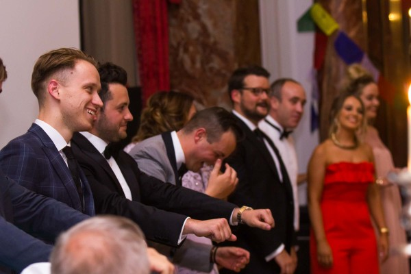 Singing waiters & waitresses getting the guests involved