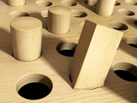 square wooden peg trying to fit in a hollow circle