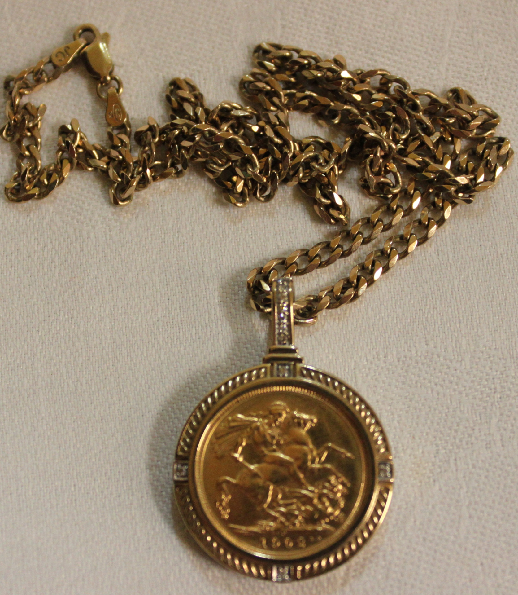 Gold Sovereign in 9ct gold holder with chain