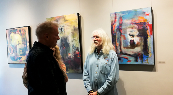Urban Gallery's owner Calvin Hambrook with guest at Passages