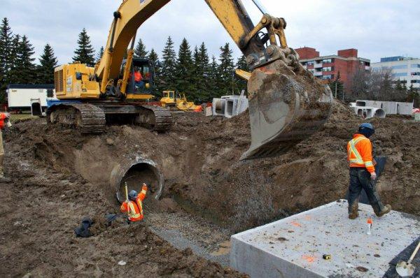 Hard-Co Eployee Directing Excavator