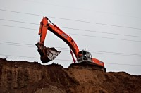 Excavator on Pile of Dirt