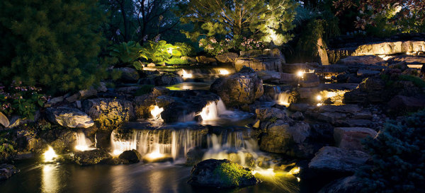water feature waterfall night lights landscape lighting