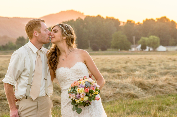 Bride and Groom from Sandy Oregon on a farm at sunset for their wedding portraits in a hay field