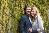 Multnomah Falls surprise engagement session bride and her fiance next to a moss covered rock wall