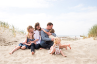 Family lifestyle portrait session at the beach mom dad and four girls