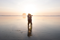 Same sex couple photographed by artist from Estacada Oregon at the Oregon Coast, two men and Haystack Rock at sunset