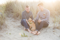 Same sex couple photographed by artist from Estacada Oregon at the Oregon Coast, two men and their dog at sunset