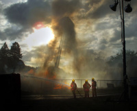 Estacada fire deptarment puts out a house fire in Oregon by Platz Photography