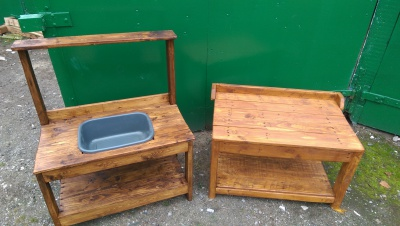 Solid wood mud kitchen with play table for outdoor play.