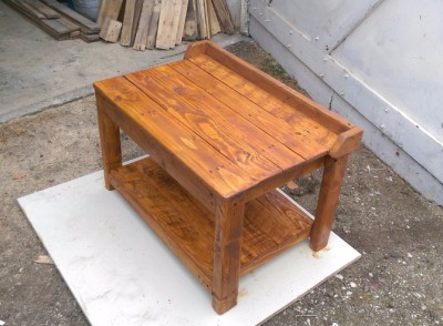 Solid wood small work bench for potting plants in the garden.