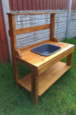 Wooden mud kitchen made from pallets.