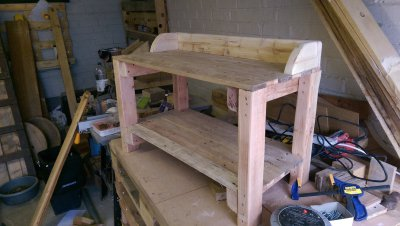 Solid wood work bench for potting plants in the garden.