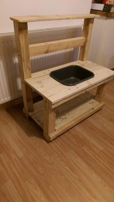 Solid oak mud kitchen with bowl.