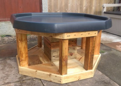 Solid wood play table with black tough tray lid for childrens outdoor messy play.