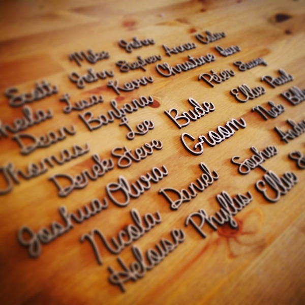 Personalised laser cut place name settings for weddings by Liverpool Pallet Designs.
