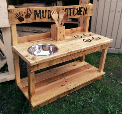 Childrens outdoor play furniture mud kitchen.