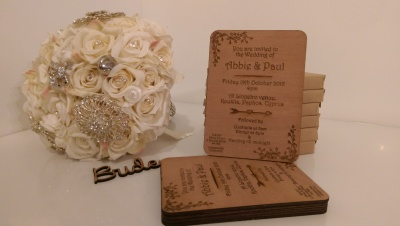 Laser cut wooden wedding invitations.