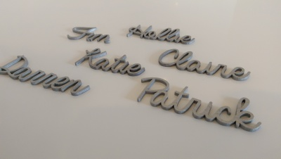 Custom silver wooden laser cut names