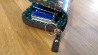 Keyring slimming counter tucked into purse discreetly.