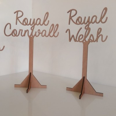 Laser cut natural wood wedding breakfast table stands.