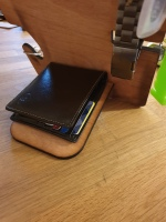 Phone holder with wallet ledge