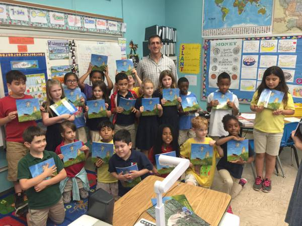 Reading to the kids at Poe Elementary