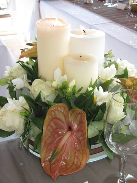 Brown anthiriums, white roses & freesias and candles of course